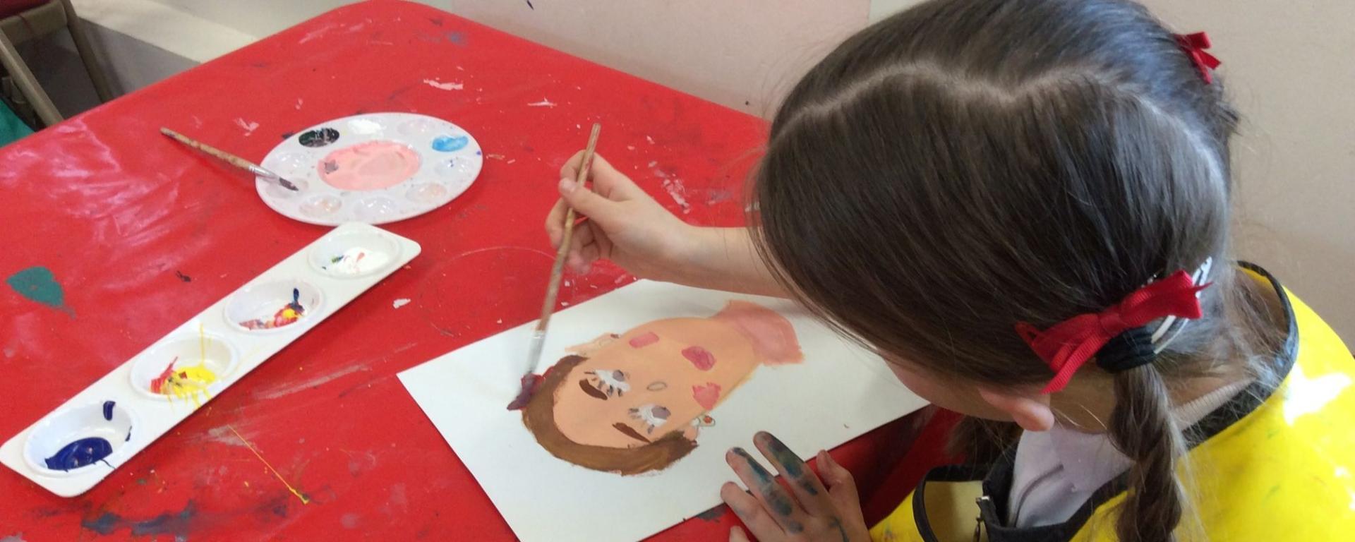 School Child Painting A Self Portrait