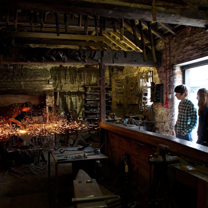 Blacksmith at work on the Victorian Street