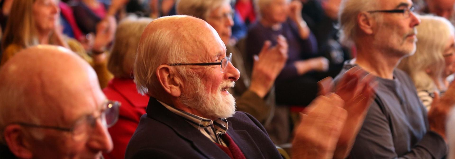 Close Up Photograph Of An Audience Enjoying A Talk