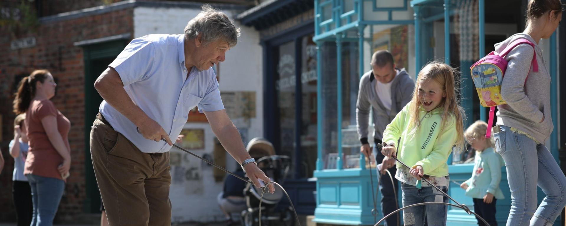 Grandad And Grandchild Playing Hoopla