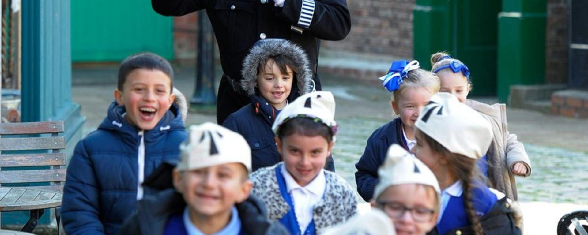 School Children Getting Chased By A Victorian Policeman On The Victorian Street