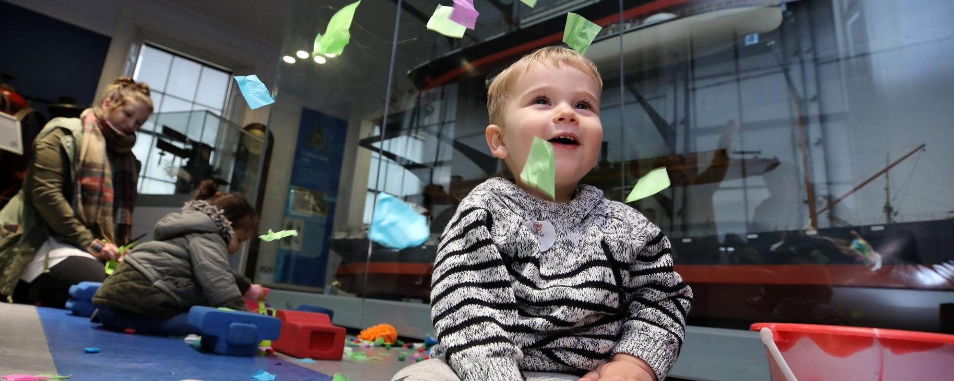 Toddler Playing With Tissue Confetti