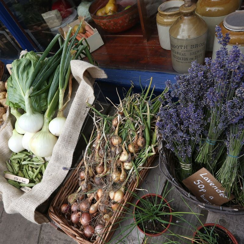 Onions and lavender on display outside of the grocers
