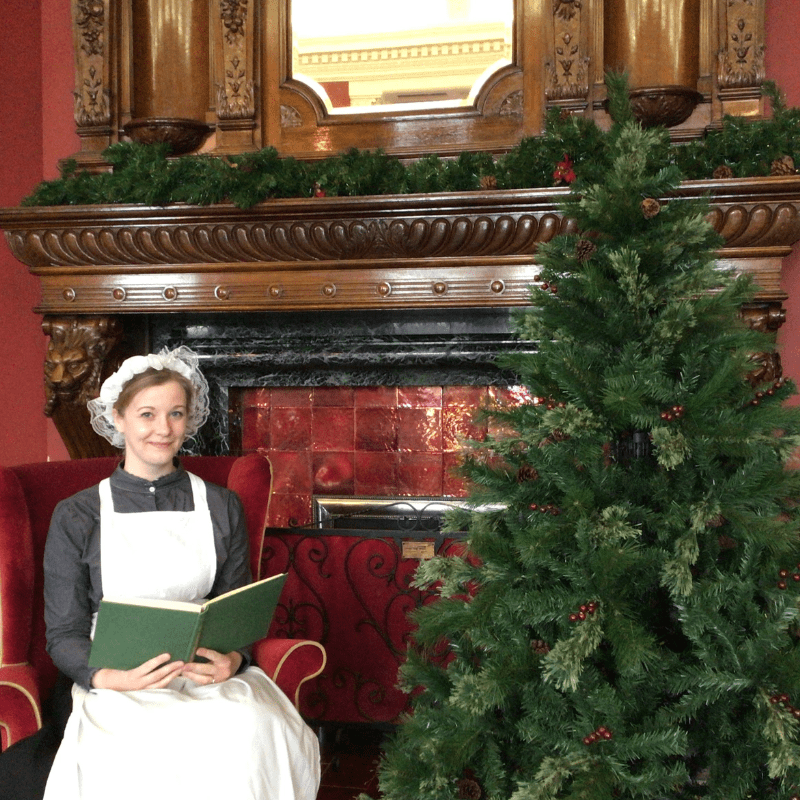 Lizzie the Victorian maid by the Christmas Tree at Preston Park