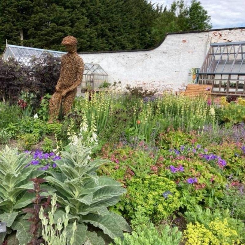 Willow Sculpture Of Lawrence Judson, Head Gardener Of Preston Hall